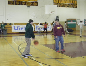 Students playing basketball at the event