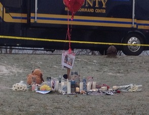 Candles still burn from yesterday evening, at the site of the memorial set up for a pair of Mount Olive teenagers.
