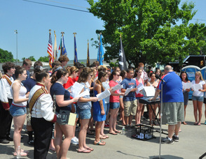 "The Newton Madrigals sing ""God Bless the USA""."