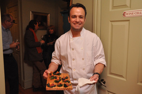 Andre de Waal with Kale Chips, one of the appetizers.