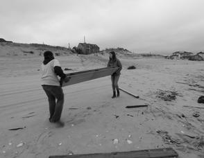 Kayla Smith and Brandon Camacho hauling a large beam