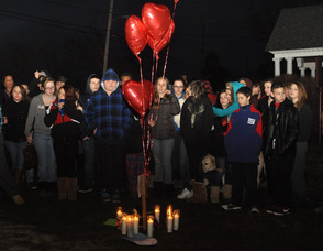 Students hug one another during the vigil.