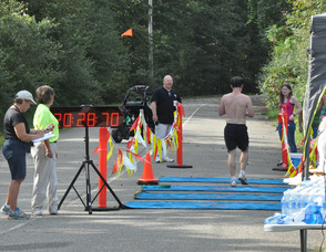 Brian Thomas passes the finish line.