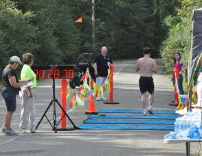 Brian Thomas passes the finish line.