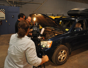 "Zaida Collazo, camerawoman for ""Today in America,"" films the team at Extreme Energy Solutions."