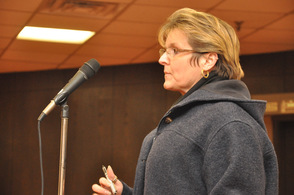 Karen Loughran asks if those who currently own land could be grandfathered in.