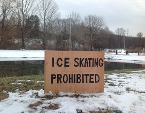 Sign in Newton's Pine Street Park, prohibiting ice skating.