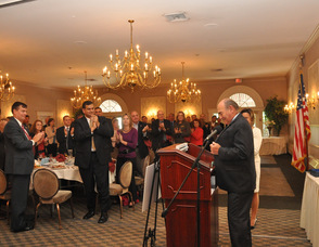 The audience gives a standing ovation to Freeholder Richard Vohden, who received the Distinctive Leadership Award.