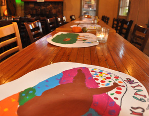 Placemats made by Art Magic, lined the tables.