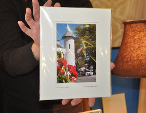 Deborah Dewey holds up a photo from Daniel Baumgartner of 35mmphotos, which made the cover of the CenturyLink phone book.