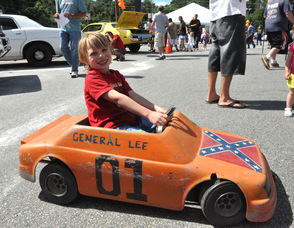 Steve Wronka, age 7, drives around Franklin Sussex Auto Mall in his mini General Lee.