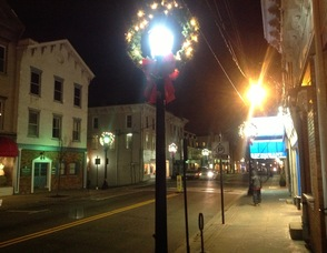 A view of Newton's Spring Street at night, with its holiday lights.