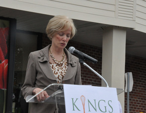 President and CEO Judy Spires at the podium.
