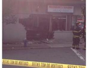 Tow Truck Plows Into Machado's Tailors on Main Street