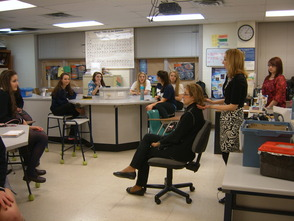 Christina Grosso of Salon FiG, teaches students about 60's hairstyles.