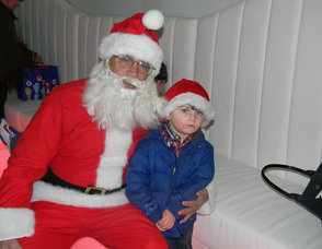 Committee Member Laura Ali Nonnenmacher's  nephew with Santa