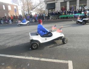 people riding mini cars