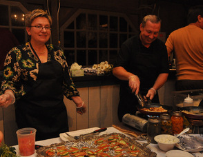 Maria and Jack Kaczynski smile as they serve up items on behalf of Bell's Mansion.