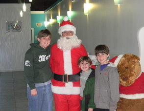 Committee Member Laura Ali Nonnenmacher's   kids with Santa