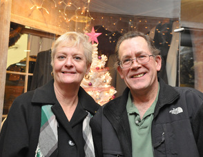 Julie and Bob Simms of Diva Designs in front of their winning window, designed by Toni Sabol.