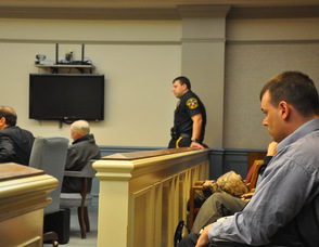 Scott Harris overlooks the courtroom, and Michael Stabile.