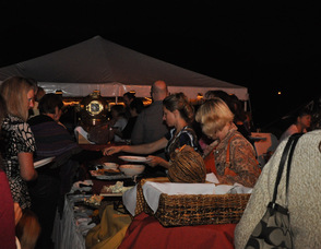 Guests enjoy the buffet by moonlight.