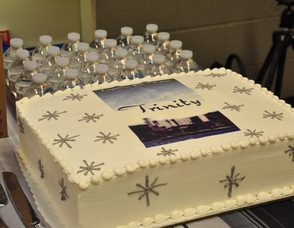 "Cake with the ""Trinity"" book cover emblazoned on it, for the book launch celebration."