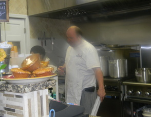 Co-owner Yoram Aflalo cooking at the cafe