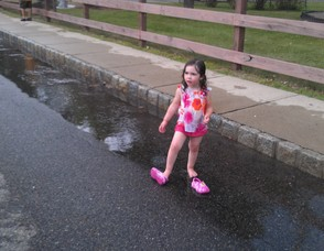 Emma Carrabba, 3, plays barefoot in the water.