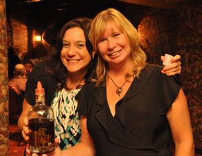 Maria Lake and Shawn Stinett serve up samples of Irish Whiskey, Irish Cream, and French Cognac.