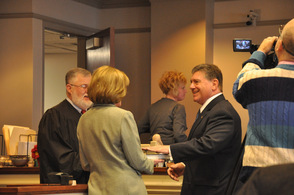 Judge Edward V. Gannon swears in Gary Chiusano to Surrogate, as his wife Carol, holds the Bible.