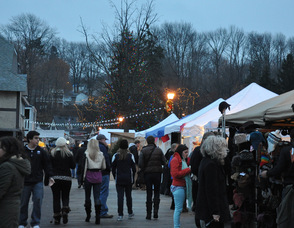 Attendees at the Lake Mohawk German Christmas Market mingle on the Boardwalk.