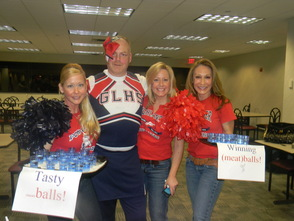 Detective Joe Williams of the Berkeley Heights PD dressed  as a cheerleader with his wife and volunteers