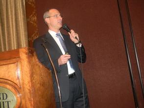 Dr. Robert Brenner speaking at the Suburban Chamber of Commerce Breakfast