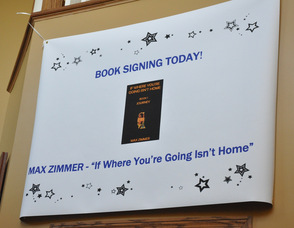 Sign greeting Max Zimmer at the book signing event.