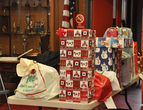 Loads of gifts in the firehouse for the second trip.