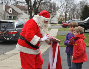 Santa visits Damon and Ronan Postance, ages 10, and 7.