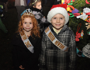 Little Miss Newton Averi Dodd, and Little Mister Newton James Detwiller, in front of the town's Christmas Tree.