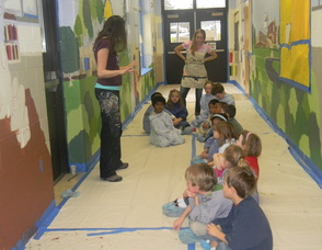 Muralist Caren Frost Olmsted speaking to the students