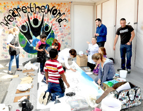 Students from the Birykov Academy, painting the mural.