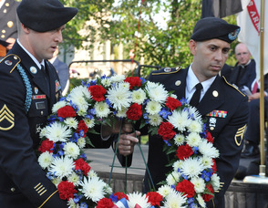 John Flynn, and Juan Maldonado carry the Fallen Military wreath.