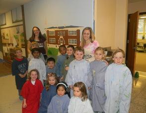 Art Teacher Jaimie Bass with the first grade students