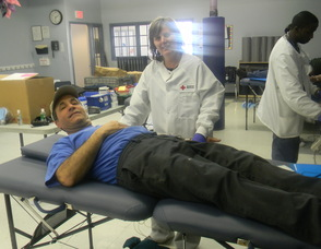 Senior Manager of the Red Cross in Philadelphia Nancy Blackledge with donor Carl Scialfa