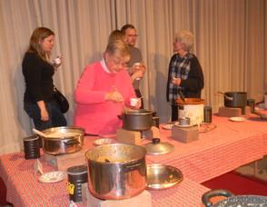 People sampling soup