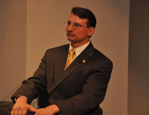 Samuel K. Burlum looks on during the question and answer portion of the session in which he was a guest speaker.