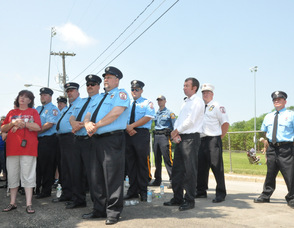 Members of the Newton Fire Department stand at attention.