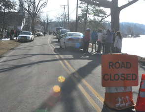 Road closed as recovery efforts continue.