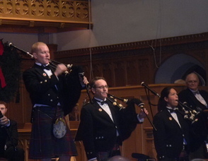Members of the Clan Currie Society bagpiping