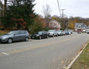 Cars wind their way along lower Spring Street in Newton for the Lukoil.