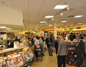 Customers mingle through the deli section.